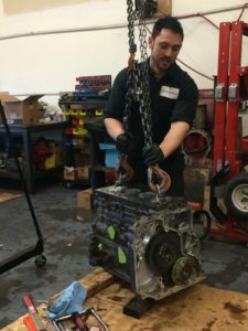 Ben working on Case 455 Reman Engine