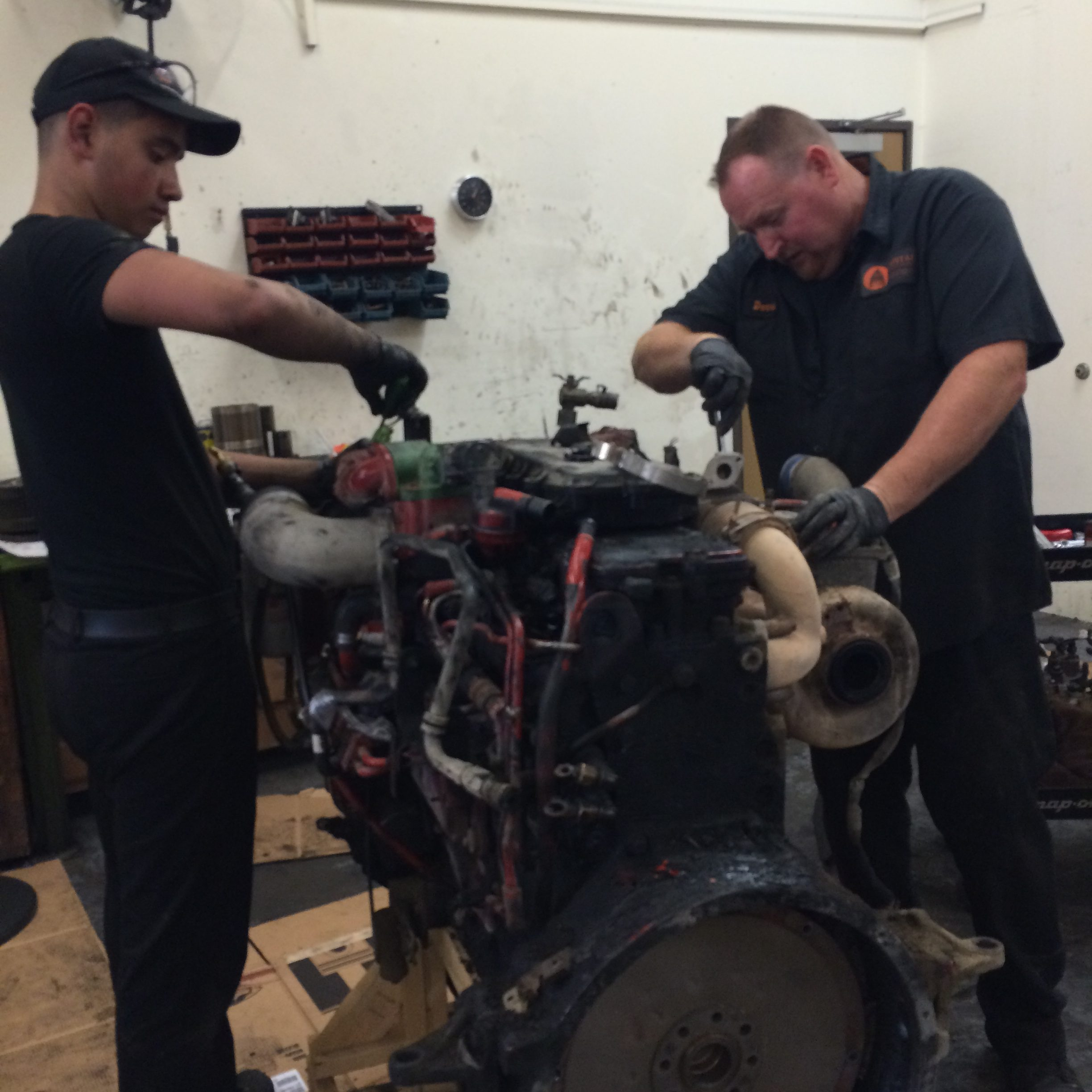 Dennis and Richard Tearing Down Diesel Engine Core